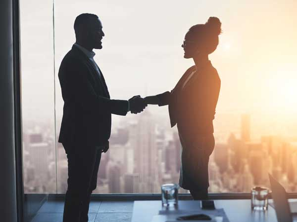 recruitment in surrey - man and woman shaking hands